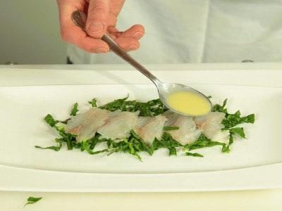 Carpaccio di spigola con spinaci