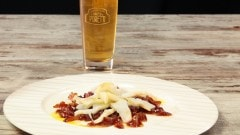 Carpaccio di baccalà con cipolla caramellata alla birra