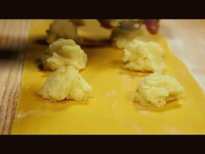 Tortelli di patate con ragù di salsiccia