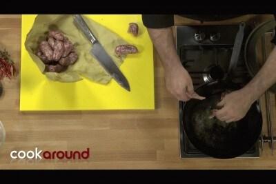 Tortelli con patate e cicoria conditi con salsicce