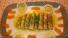 Trancio di spada in salsa d'agrumi e pomodori verdi