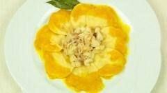 Ravioli di patate con ragu di coda di rospo lardo e salsa allo zafferano