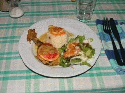 Cosce di pollo con curry ed arancia
