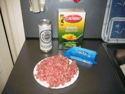 Risotto con salsiccia, birra e stracchino
