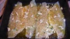 Branzino al forno con pistacchi e arancio