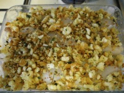 Calamari ripieni di carciofi su letto di patate