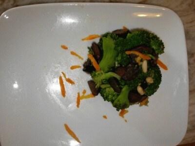 Broccoletti ripassati con olive, aglio, pinoli e arance
