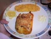Petto di pollo impanato al forno con peperoni ripieni di cous cous