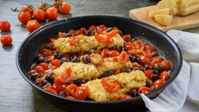 Trancio di merluzzo con pomodorini e olive di gaeta